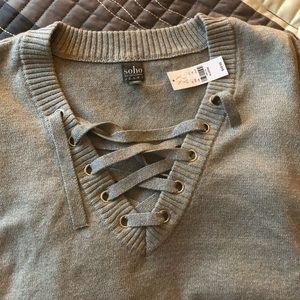 A beautiful silver sweater w/quarter sleeves